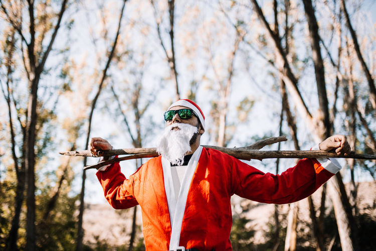 Man wearing costume while standing in forest