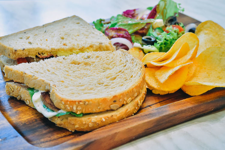 Sandwich With Chips And Greens Bread Breakfast Chips Close-up Food Greens Healthy Eating No People Sandwich Sandwiches Vegetables