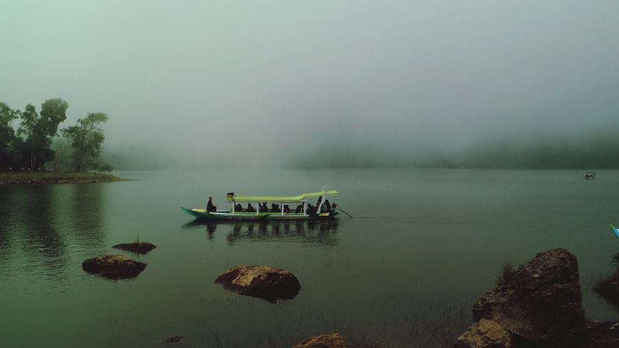 Water Lake Fog Nature Tranquility No People Boat Outdoors Beauty In Nature INDONESIA Cloud Misty Misty Landscape