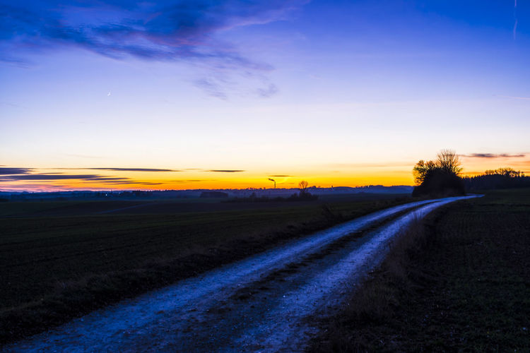 Exploring Style Sunset Scenics Landscape Beauty In Nature Agriculture Rural Scene Sky Tranquility Tree Outdoors Nature Dramatic Sky Road Field No People Day EyeEm EyeEm Gallery ARTsbyXD Backgrounds Xd_arts EyeEmBestPics EyeEm Best Shots Stockphotography The City Light