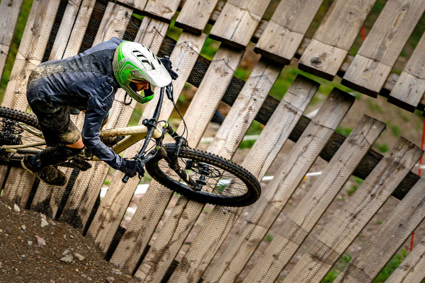 Enduro bike rider in the wall. Tire Headwear Bicycle Stunt Land Vehicle Full Length Riding High Angle View Close-up Bicycle Rack Biker Cycling Cycling Helmet Mountain Bike Bmx Cycling Racing Bicycle Pedal Bicycle Basket
