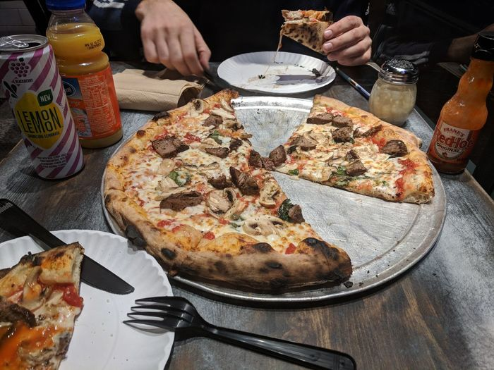EyeEm Selects pizza brick oven Pizza Food And Drink Table Italian Food Human Hand Food Ready-to-eat Unhealthy Eating Take Out Food Serving Size SLICE Indulgence Fast Food Cheese Human Body Part Indoors  Plate Temptation Meal Freshness