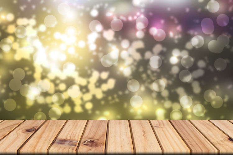 Backgrounds Bright Brightly Lit Celebration Day Defocused Event Focus On Foreground Illuminated Lens Flare Light - Natural Phenomenon Nature No People Outdoors Pattern Selective Focus Shiny Sunlight Surface Level Table Wood Wood - Material