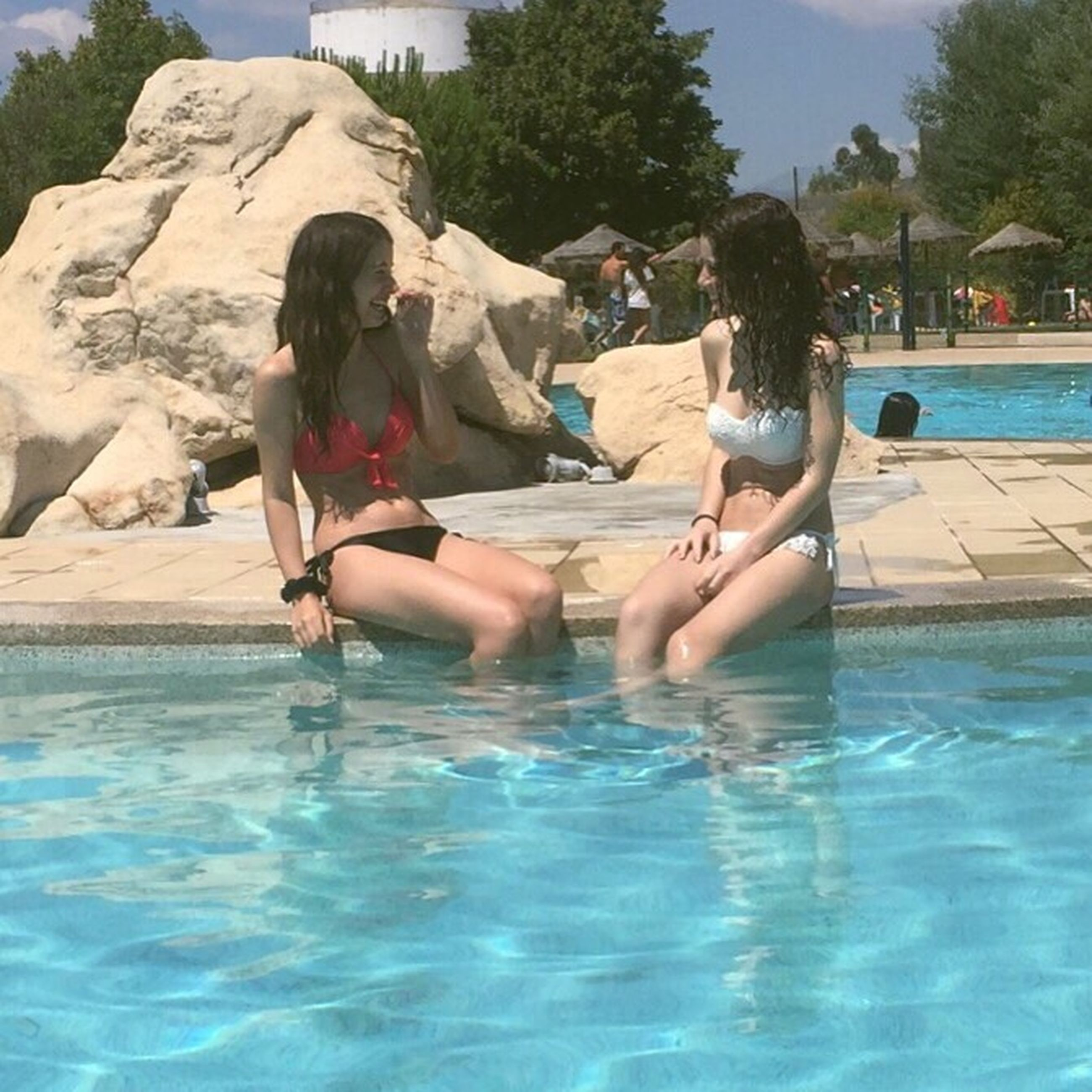 water, lifestyles, leisure activity, enjoyment, swimming pool, vacations, full length, fun, tree, relaxation, summer, casual clothing, day, outdoors, nature, blue, turquoise colored