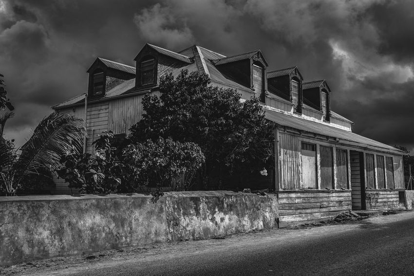 Abandoned Wooden Abandoned Old Buildings Streetphotography Caribbean Blackandwhite Nikon D750 Photographyisthemuse Travel Destinations Architecture Built Structure Sky Cloud - Sky Building Exterior Tree No People Outdoors Day Low Angle View