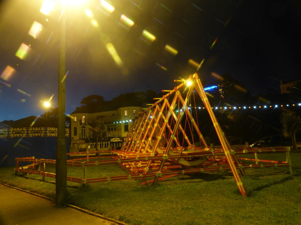 night, illuminated, built structure, lighting equipment, no people, architecture, light beam, outdoors, sky, building exterior, grass