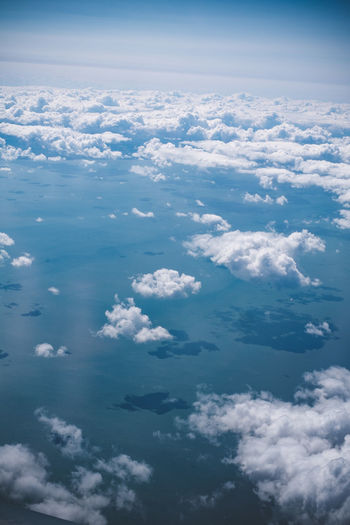 Traveling in the air, over the ocean Cloud - Sky Sky Beauty In Nature Nature No People Day Outdoors Scenics - Nature Tranquility Blue Cloudscape Tranquil Scene Idyllic Aerial View White Color Backgrounds Environment Heaven Fluffy Sunlight Meteorology Softness Above