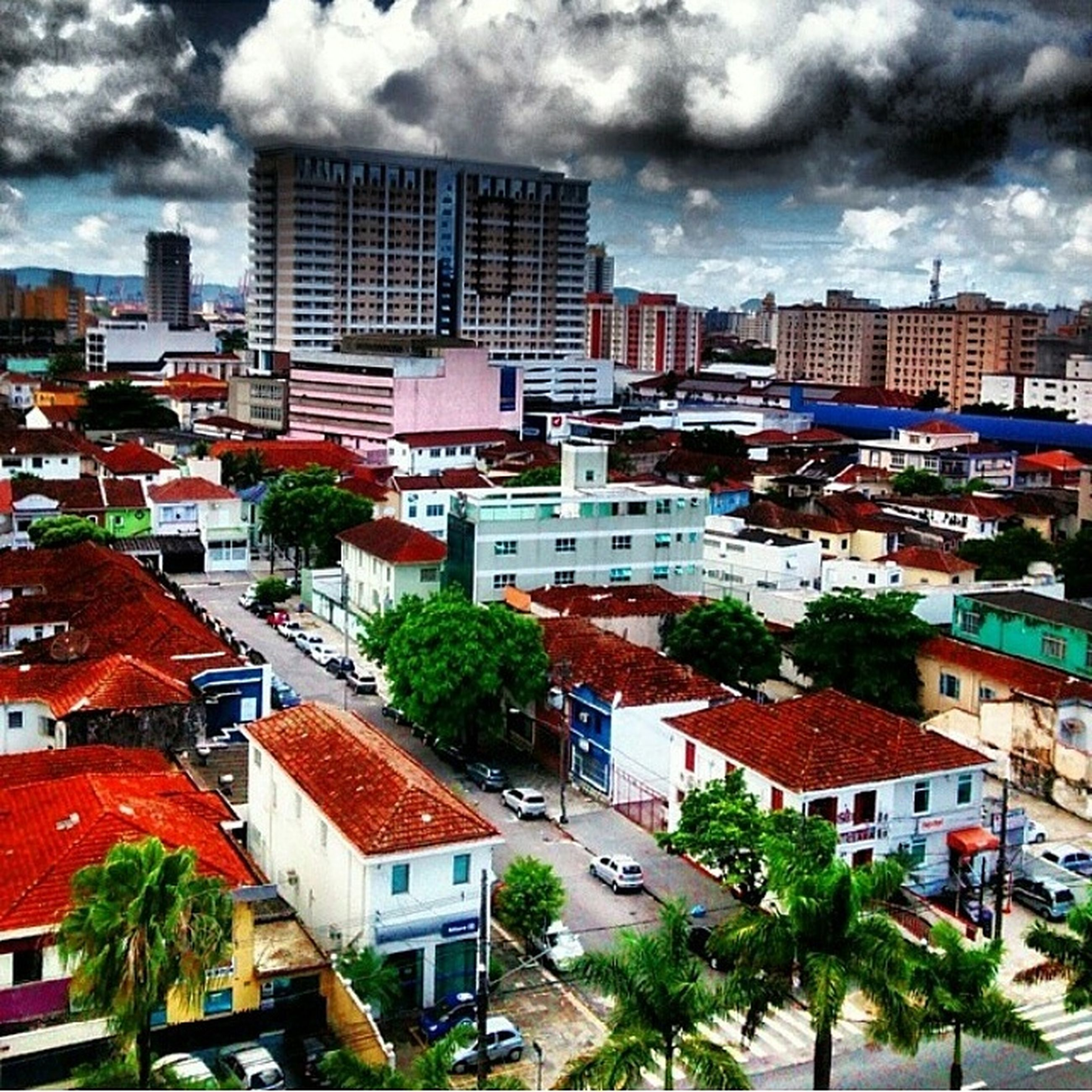 building exterior, architecture, built structure, sky, city, cloud - sky, cloudy, residential district, residential building, cityscape, residential structure, cloud, house, high angle view, tree, building, crowded, city life, outdoors, day