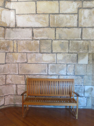 Chair against brick wall