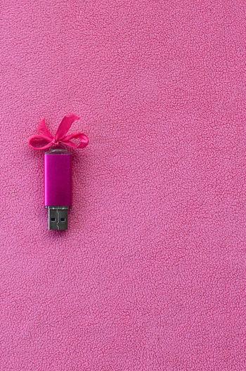 Usb stick on pink fabric