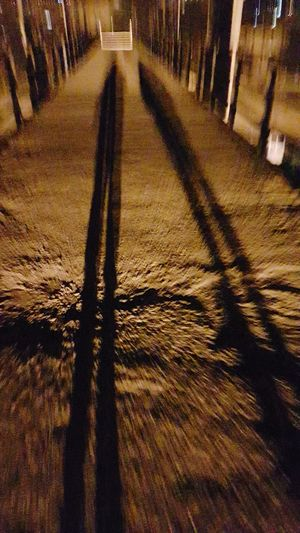 #oldbridge Night Lamplight Coupleshot Shadow Focus On Shadow Long Shadow - Shadow Empty Road vanishing point The Way Forward Pathway Diminishing Perspective Double Yellow Line Asphalt
