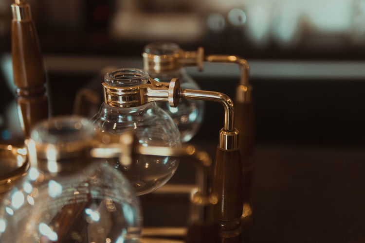 Close-Up Of Empty Glass Containers On Table