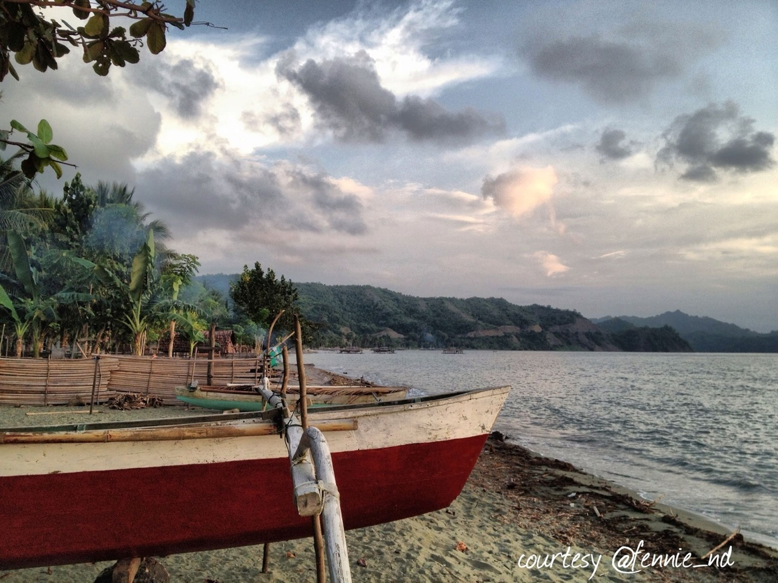 water, sky, nautical vessel, boat, sea, tranquility, tranquil scene, cloud - sky, scenics, nature, beauty in nature, mountain, transportation, moored, cloud, lake, cloudy, pier, tree, mode of transport