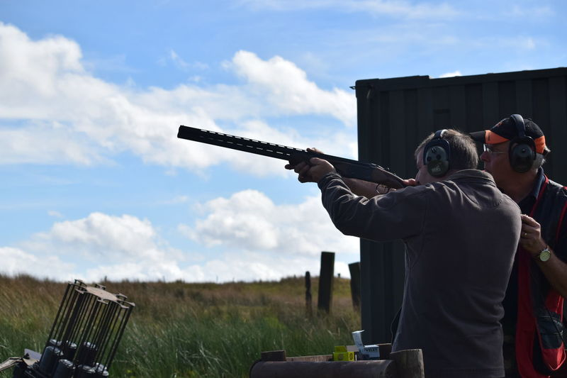 Clay Pigeon Day Men Outdoors People Shoot Shooting Photos Sky Weapon Fresh On Eyeem  Eyeem Market