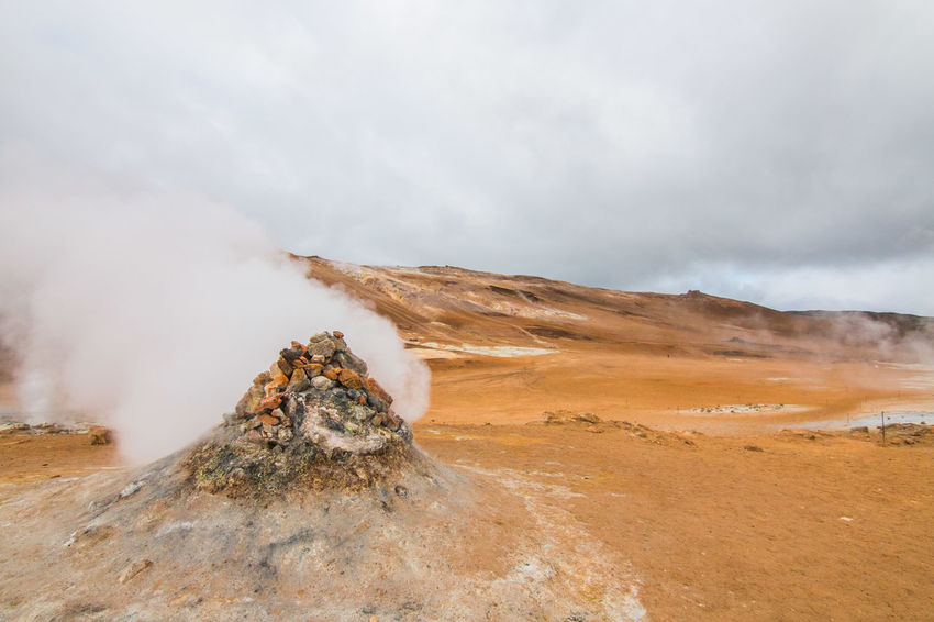 scenic view of landscape against sky Myvatn Beauty In Nature Geology Landscape Nature No People Outdoors Physical Geography Power In Nature Scenics Smoke - Physical Structure Steam