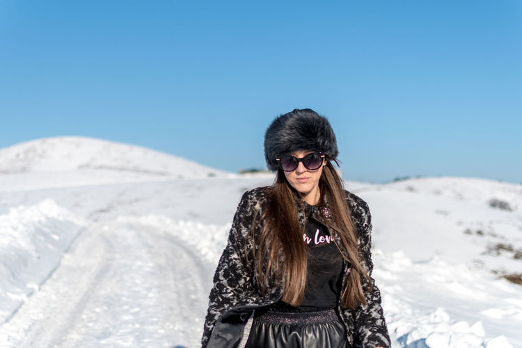 One Person Fashion Sky Glasses Clear Sky Sunglasses Leisure Activity Lifestyles Clothing Hair Young Adult Long Hair Front View Hairstyle Sunlight Standing Young Women Real People Nature Day Warm Clothing Beautiful Woman Outdoors