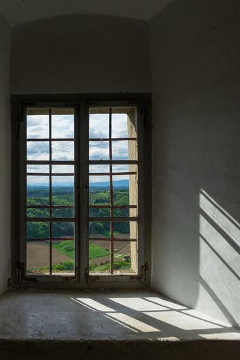Sunlight falling on glass window of house