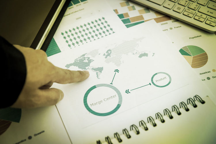 Preparing report graphs and charts. Business reports pile of documents and laptop on table Accountancy Accountancy Business And Management Business Concepts Preparing Report Activity Analyzing Body Part Business Report Business Strategy Charts Charts And Graphs Close-up Finance Finger Hand High Angle View Holding Human Body Part Human Finger Human Hand Indoors  Lifestyles Men One Person Paper Preparing Real People Report Solution Table Working