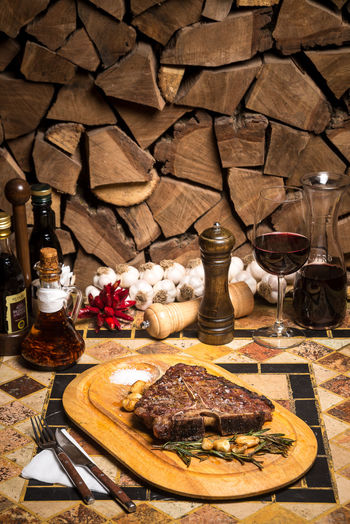 Beef Beef Steak Cooking Dinner Alcohol Beefsteak Bottle Cheese Cutting Board Day Drink Drinking Glass Food Food And Drink Freshness Indoors  No People Plate Ready-to-eat Restaurant Serving Dish Spice T-bone T-bone Steak Table Wine Wineglass