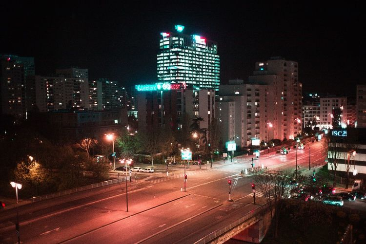 View of city lit up at night
