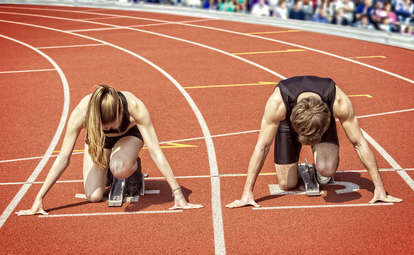 Athletes at starting line on running track