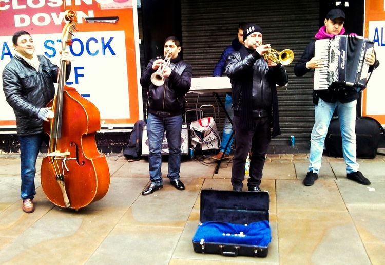 Street entertainers on Market street 04/02/16. Manchester town centre. Street Entertainers Jazz Trumpets Double Bass Manchester Party Music Culture