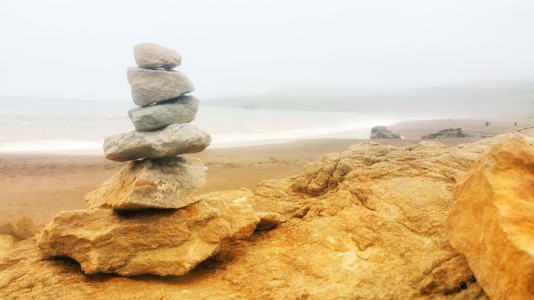 Meditation Stones -By the Sea Foggy Mist Golden Light Zen Meditation Stones Meditation Stones Timeless Background Copy Space Sandstone Distance Soft Hazy  Foreground Focus Design Bold Merging Passion Peace Dreams EyeEm Selects Beach Sand Sand Dune Sea Sky Horizon Over Water Foggy Surf