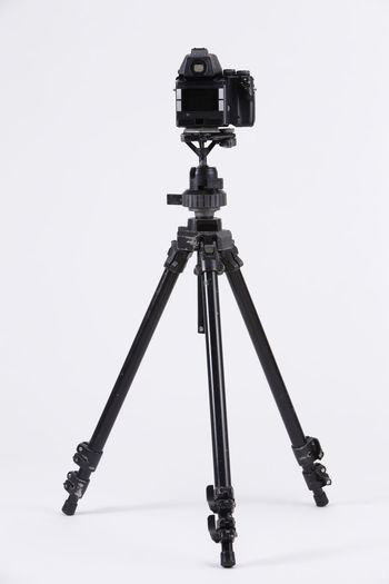 studio shot of high end digital camera on the tripod Camera Photography Multimedia Expertise Professional Occupation Tripod Photograph DSLR Lens Equipment Photographic Theme Photographing Black Nobody White Background Medium Format Camera Photography Themes Technology Studio Shot Camera - Photographic Equipment Indoors  No People Still Life Photographic Equipment Close-up Digital Camera Copy Space Single Object High End Medium Format Rear View Back View Gray Background Gray Filming Activity