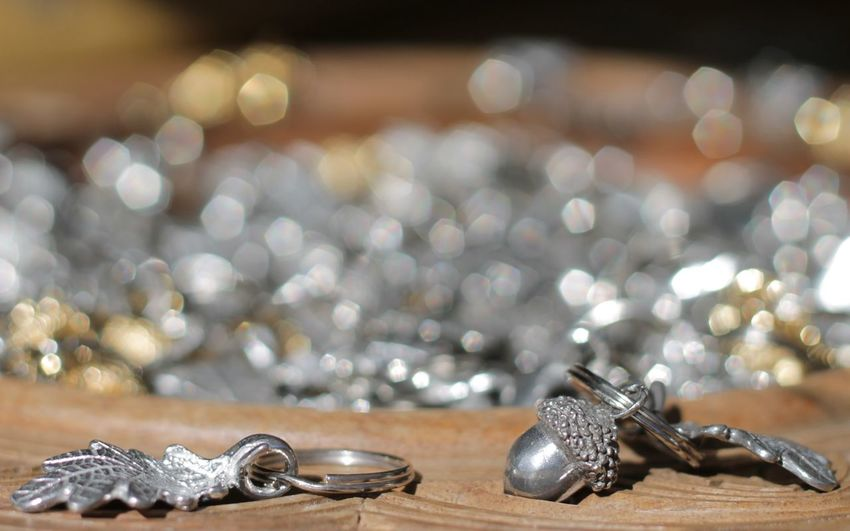 Close-up of silver key rings on wooden container