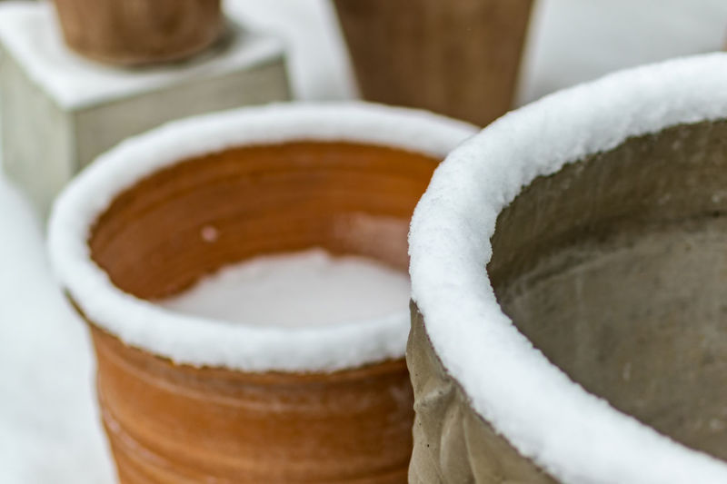 earthenware flowerpots outdoors in snow winter Winter Clay Close-up Cold Temperature Earthenware Flowerpot Flowerpots No People Outdoors Pottery Snow