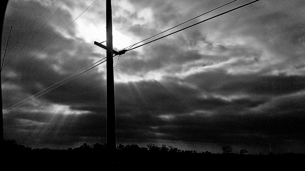 Glimpsed Of Light Shining Through Darkness Storm Clouds Rumbling Skies Light Vs. Dark Heaven And Earth Power Line  Electric Pole Cross Sky Silhouette Electricity  Outdoors Sunshine And Shadows Shades Of Light Sunshine After A Storm Rural Scene Simply Beautiful What I See From My Truck Window Passenger View Mother Nature Spring2017 California USA Driving Home Countryside Glamour