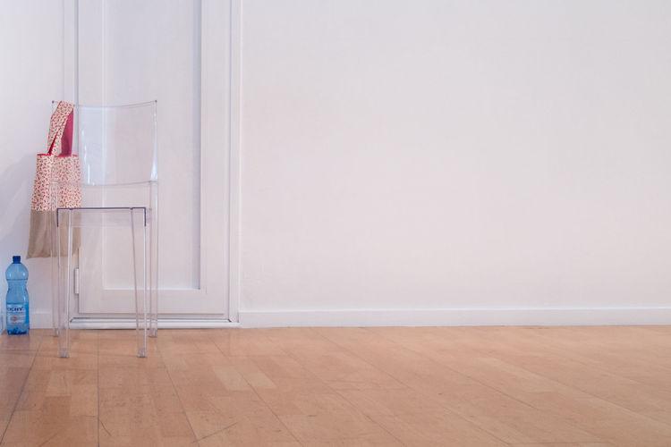 Empty Chair In Front Of Closed Door