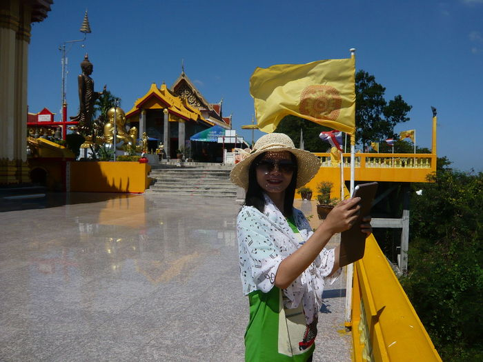 ThaiTemple Portrait Smiling Young Women Arts Culture And Entertainment Sky Yellow