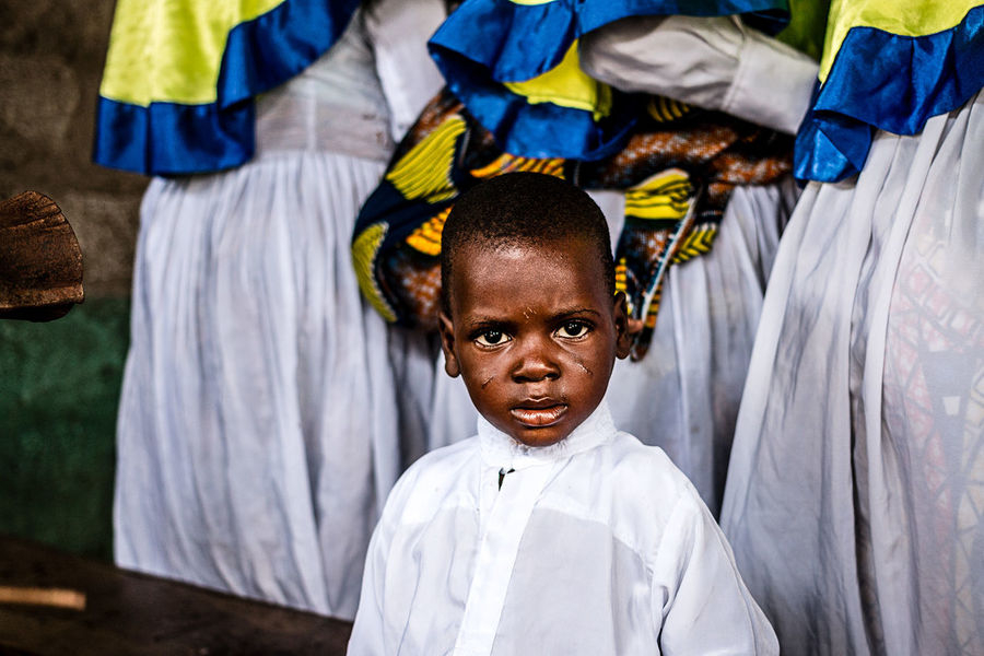 Young Adept in the convent during a voodoo ceremony | Ganvié, Southern, Benin Adept Africa Benin Boys Ceremony Child Childhood Convent Ganvie Looking At Camera People Portrait Real People South Standing The Photojournalist - 2017 EyeEm Awards Voodoo Young