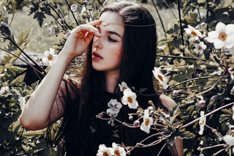 Attractive woman in flowers