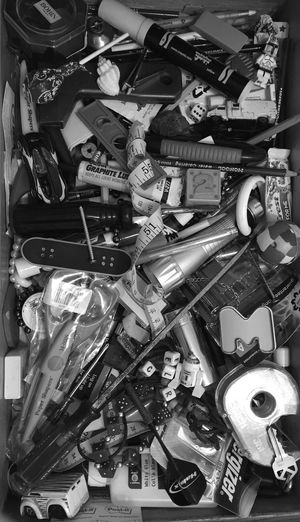 Bnw_friday_eyeemchallenge EyeEmSpy Junkdrawer: I spy 3 hot wheels, a skateboard, A bottle of glue. 3 screwdrivers, a key and R2D2. A dart, a shell, M, a screw. A storm trooper, a sucker, a ball, and the number two. ISpy  Ispy_withmy_photoeye