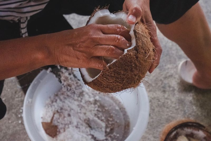 Body Part Lifestyles One Person Real People Human Body Part Hand Human Hand Food And Drink Preparation  Indoors  Food Flour Holding People Two People Adult Bowl Women Preparing Food Freshness Ingredient Mixing Kneading