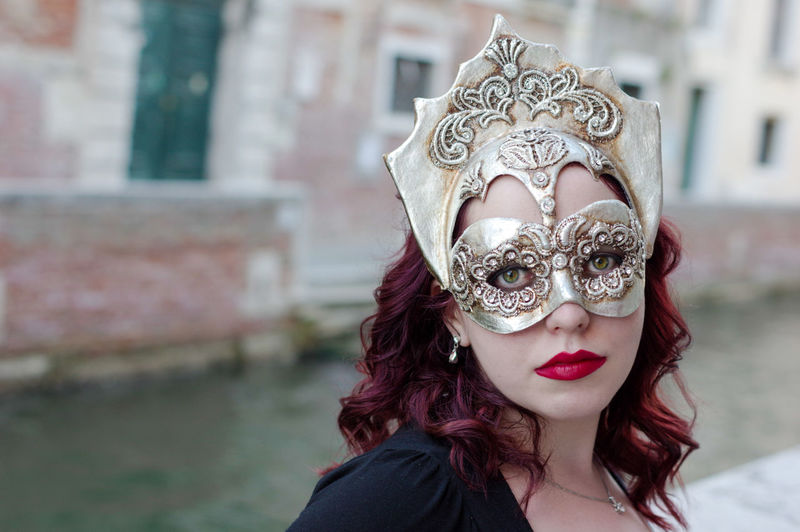 Portrait Of Woman Wearing Mask By Canal During Carnival