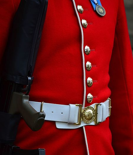 Guard in a red uniform holding a rifle Brass Buttons Buttons Close-up Detail EyeEm Best Shots Full Frame Guard Gun Pjpink Red Uniform Weapon White Belt