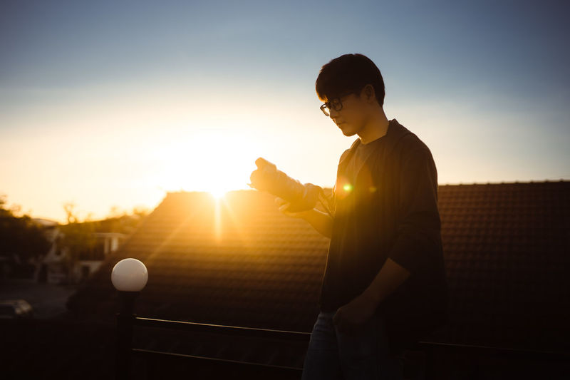Man playing with ball at sunset