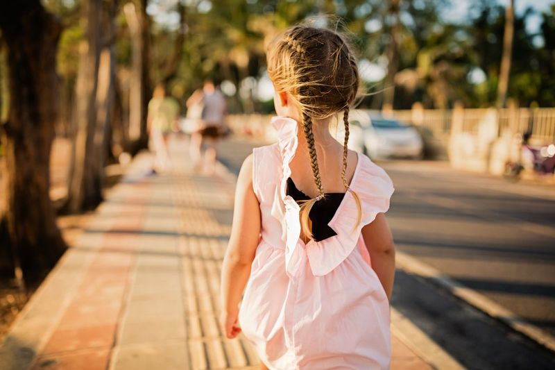 Walking Girl Power Childhood Childhood Memories Child Tropics Summer Vacation Summer Vibes Summer in the City Summertime Fashionable Stylish Dress Lifestyle People Lifestyle Photography Lifestyle Girl Behind One Person Lifestyles Focus On Foreground Real People Women Sunlight Leisure Activity Casual Clothing Adult Hairstyle Hair Teenager