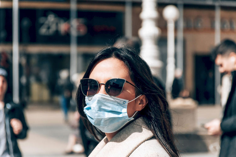Portrait of woman with face mask in city. covid, corona, epidemic, virus, protective mask.
