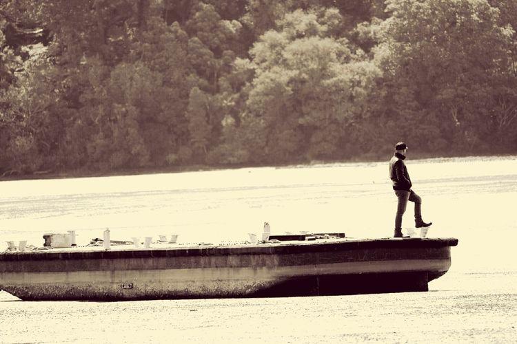 Full length of man on water
