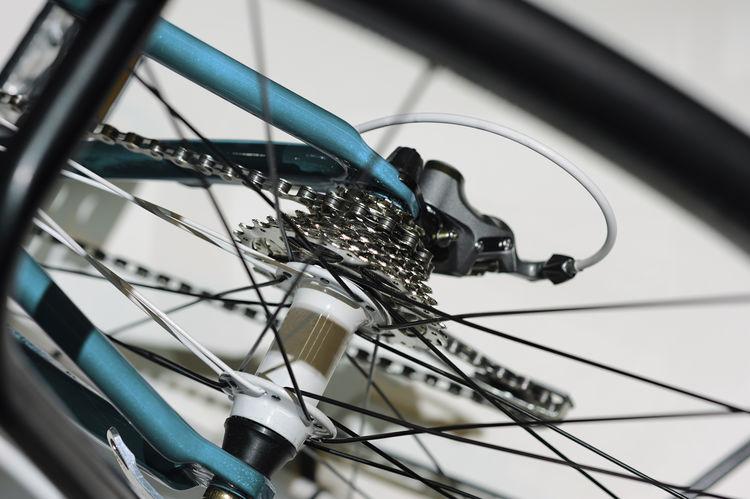 close up of a racing bike Bike Bikecycle Bikewheels Chain Close-up Gear Land Vehicle Mode Of Transport No People Racing Bike Selective Focus Thin Transportation Wheel