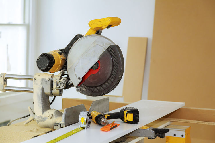 Close-up of work tools on table at carpentry workshop