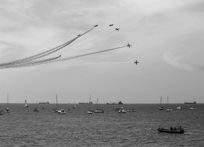 Mode Of Transportation Transportation Sky Cloud - Sky Flying on the move Nautical Vessel Airshow Air Vehicle Motion Airplane Nature Travel Day Smoke - Physical Structure Water Speed Fighter Plane Vapor Trail Cooperation Plane Teamwork Outdoors No People Sailboat Blackandwhite Black And White Black & White Skyporn