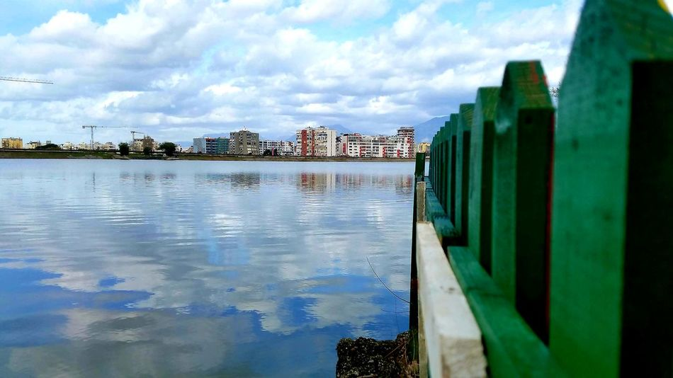 Cloudy Day Artificial Lake Of Tirana Cityscape Photography Cityscape Reflections In The Water Green Color Water Sea Beach Reflection City Sky Architecture Cloud - Sky Building Exterior Groyne Calm Horizon Over Water Lakeside Cloud Waterfront Standing Water Coastline