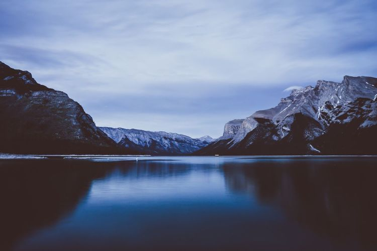 Lake Minnewanka Water Sky Mountain Scenics - Nature Beauty In Nature Waterfront Cloud - Sky Lake Tranquil Scene Nature Tranquility Reflection Cold Temperature No People Winter Snowcapped Mountain Snow Idyllic Outdoors