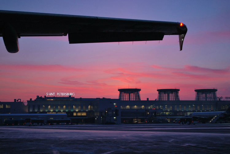 Sky Sunset Built Structure Building Exterior Architecture Nature No People Cloud - Sky Dusk City Transportation Illuminated Outdoors Airport Runway Orange Color Airport Water Air Vehicle Street Airplane Airplane Wing Aircraft Aircraft Wing