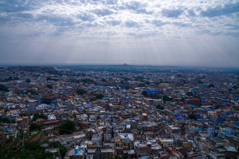 Aerial View Blue City City Cityscape Cloud - Sky Community Elevated View Famous Place Horizon Over Land Human Settlement India Jodhpur Mehrangarh No People Rays Rays Of Light Residential Building Residential District Sky Tourist Attraction  Tourist Destination Town TOWNSCAPE Travel Destinations